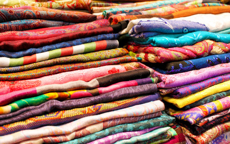 Stacks of colorful fabrics and textile close up background 스톡 콘텐츠