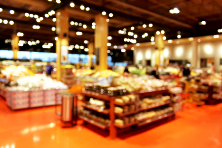 store display: Grocery store blur bokeh background - shoppers at grocery store with defocused lights