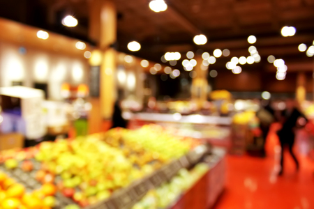 produce departments: Store blurred background - shoppers at grocery store blur with bokeh background