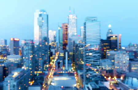 Abstract defocused city dusk background with bokeh lights, Toronto, Canada