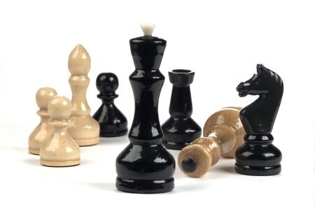 chess-series group of figurines on white  photo