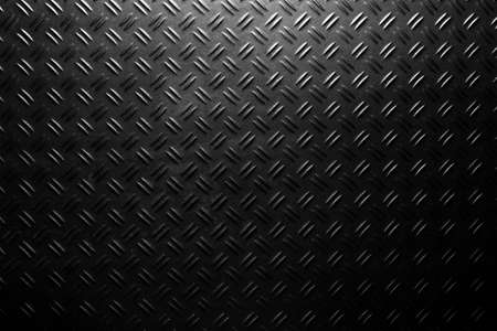 black checker plate background texture with light spot