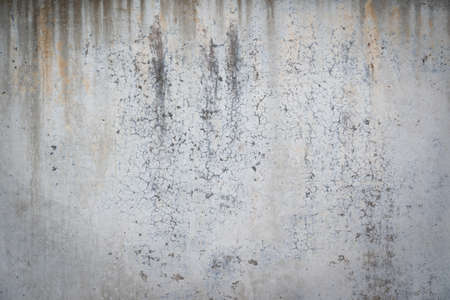 dirty leaking cracked concrete backgroud texture wall with copy space