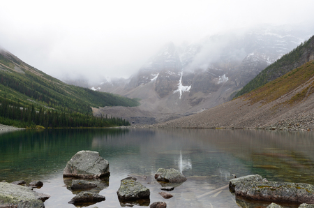 Rocks and Mountains at the Consolation Lakes on a rainy and cloudy day.