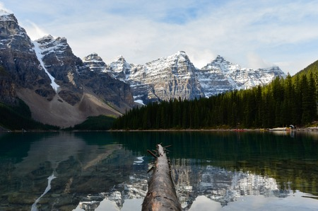 The mountains mirror perfect in the water surface of the moraine lake in Canada. Reklamní fotografie