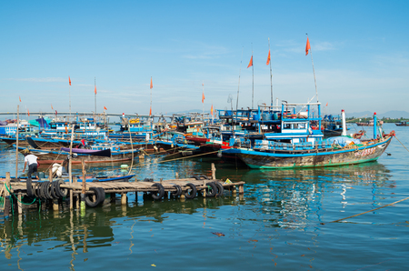Hoi An, Vietnam - August 15, 2015: Vietnamese fishing boats on the Vin Cura Dai river, the mouth of the Thu Bon river near Hoi An in Vietnam. Editorial