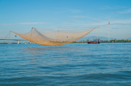 trawler net: Vietnamese fishing boats on the Vin Cura Dai river, the mouth of the Thu Bon river near Hoi An in Vietnam.