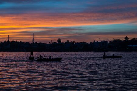 can tho: Can Tho, Vietnam - August 12, 2015: Traditional boats on the Can Tho River in Can Tho, Vietnam at sunrise.