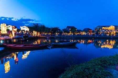Hoi An city lights across the Thu Bon river in Vietnam