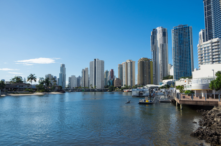 surfers paradise: Gold Coast, Australia - July 12, 2017: modern apartment buildings on the banks of the Nerang River in Surfers Paradise, part of the rapidly growing Gold Coast City. Editorial