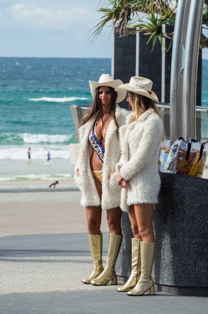 guides: Gold Coast, Australia - July 11, 2017: Gold Coast meter maids in Surfers Paradise. Meter maids are employed as tourist guides.