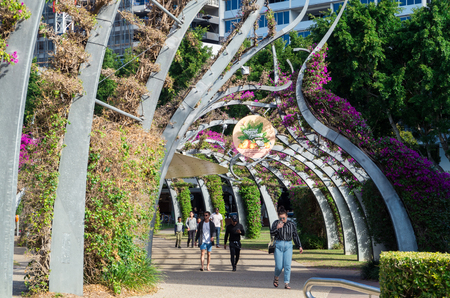 Brisbane, Australia - July 9, 2017: The Arbour is a pedestrian walkway running the length of the Brisbane South Bank parklands. The structure is covered in bougainvillea. Editorial