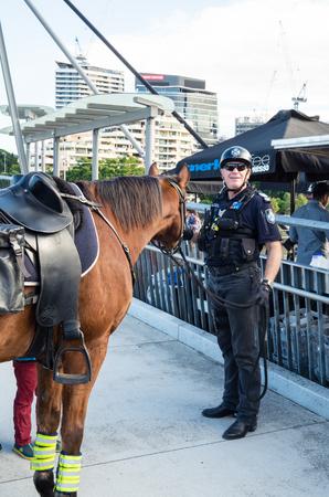 Brisbane, Australia - July 9, 2017: Queensland mounted police officer on the Goodwill Bridge crossing the Brisbane River in central Brisbane.