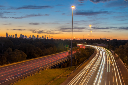 Traffic on the Eastern Freeway at dusk, passing through Yarra Bend Park, as seen from the Yarra Boulevard bridge.