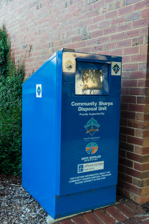 Leongatha, Australia - January 28, 2018: community sharps disposal unit in Leongatha in South Gippsland. The sharps disposal unit is for disposal of syringes and needles. Editorial