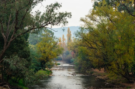Smoke haze from burnoffs hangs over the Ovens River in Bright in north eastern Victoria, Australia.