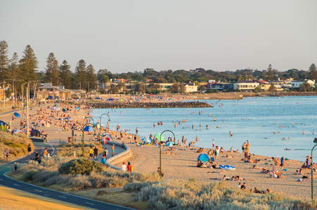 People on the sand and in the water at Elwood Beach in the inner urban suburb of Elwood.
