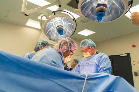 Melbourne, Australia - June 7, 2019: surgeons performing a caesarean section in an operating theatre in the Royal Women's Hospital. Editorial