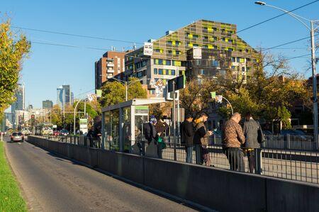 Melbourne, Australia - June 7, 2019: Tram stop on Flemington Road in Parkville, outside the Royal Children's Hospital. Yarra Trams operates the Melbourne tram network. Editorial
