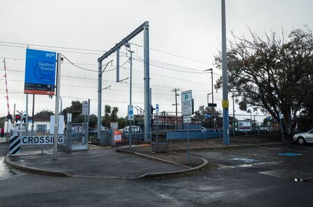 Melbourne, Australia - August 10, 2019: Seaford railway station and level crossing in suburban Seaford. The station is on the suburban Frankston Metro line.