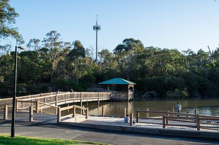 Melbourne, Australia - November 3, 2018: Wooden causeway crossing Ringwood Lake, a body of water in the outer suburban Ringwood Lake Park in the City of Maroondah. Editorial