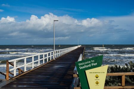 Melbourne, Australia - August 10, 2019: Seaford Pier is a timber pier built in the 1920s in the south-eastern suburb of Seaford. It is seen here on a windy winter morning.