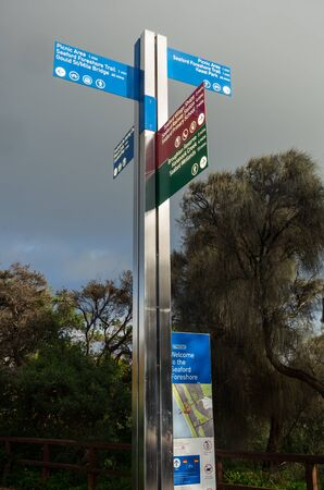 Melbourne, Australia - August 10, 2019: signpost on the Seaford foreshore in suburban Melbourne. It points to the primary school, railway station and village shops
