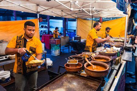 Melbourne, Australia - March 6, 2019: a man preparing Sri Lankan street food at the Queen Victoria Market night market. The night market operates annually, once a week.