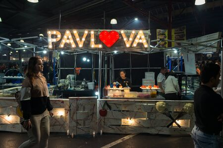 Melbourne, Australia - March 6, 2019: Pavlova stall selling dessert at the Queen Victoria Night Market. The night market runs weekly during summer.