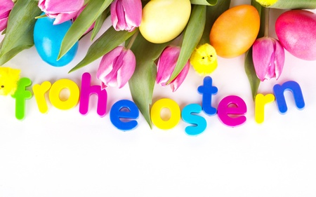 tulip wit eastern eggs a rabbit and letters in different colours photo
