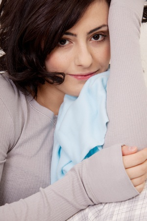 young beautiful woman is sitting an a sofa and relaxing Stock Photo - 12784830