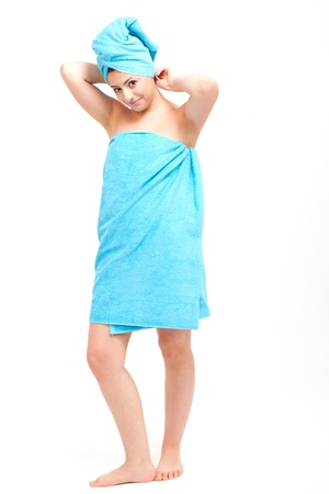 young beautiful woman with a towel doing wellness Stock Photo