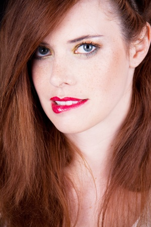 portrait of a beautiful young woman with red hair and red lips Stock Photo