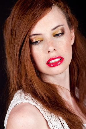 portrait of a beautiful young woman with red hair and red lips photo