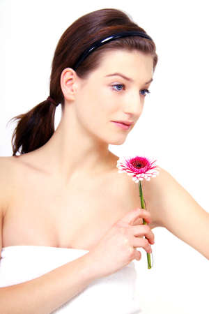 young beautiful brunette woman with flower Stock Photo - 12784970