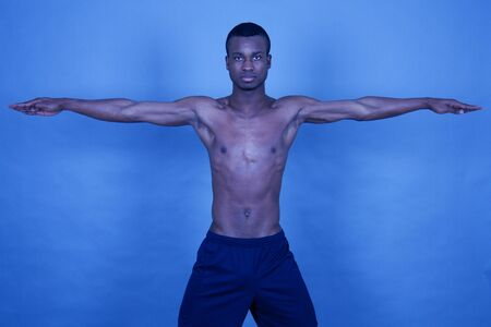 young man with black skin ist doing fittness photo