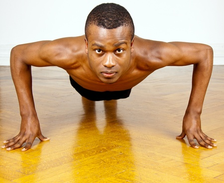 young man with black skin ist doing fittness