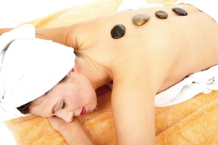 young beautiful brunette woman doing wellness with massage photo