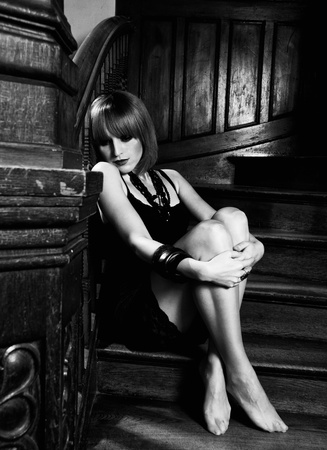 woman stairs: beautiful redhead woman on stairs indoor emotinal glamour