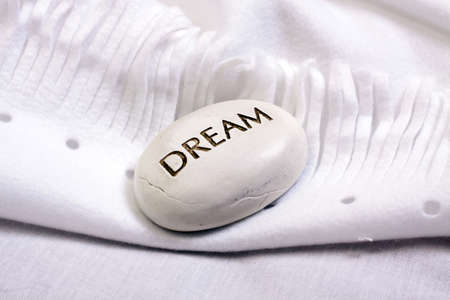 white dream stone on a white blanket  Stock Photo - 13454545