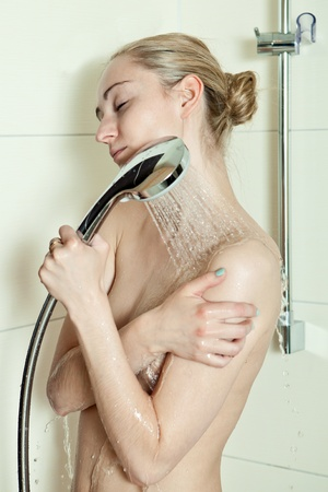 woman is taking a shower and relaxing photo
