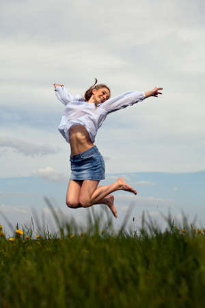 young woman is happy outdoor in summer photo