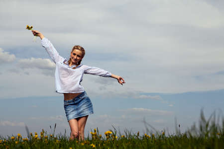 young woman is happy outdoor in summer Stock Photo - 13484521