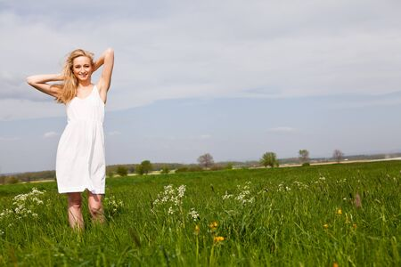 beautiful blonde woman outdoor in summer happy photo