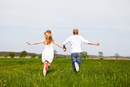 young happy couple have fun in summer outdoor in nature Stock Photo - 13547860