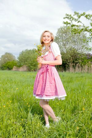young woman with pink dirndl outdoor in summer Stock Photo - 13563699