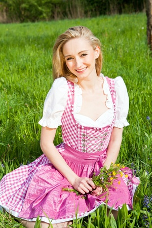 german girl: young woman with pink dirndl outdoor in summer Stock Photo
