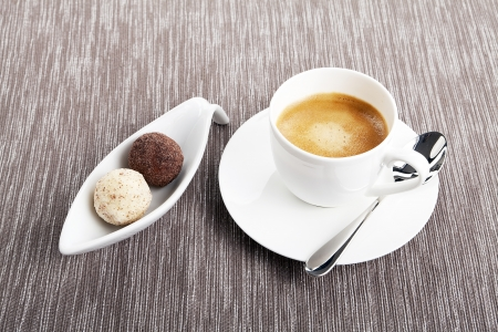cup of coffee with mixed pralines  photo