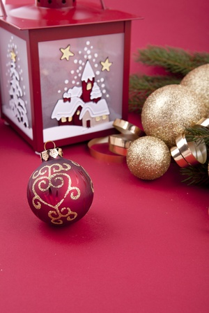beautiful christmas decoration in gold and red color with tree and lamp photo