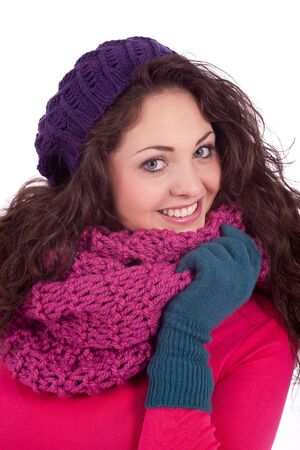 beautiful young smiling girl with hat and scarf in winter isolated on white background photo